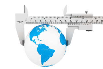 Metal Vernier Caliper with Earth Globe on a white background